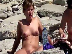 Naked beach girls chit chatting