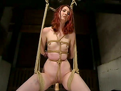 Redhead girl gets tied up and toyed by a police officer