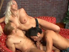 Nicki Hunter assists two bisexual handsome guys in cock sucking