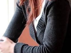 Sensual redhead babe stripping