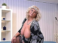 Busty blonde BBW mature MILF Renatte sucks a huge fake cock