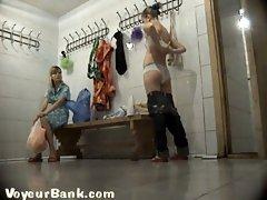 Lovely pair of cute girls in the locker room filmed nude