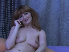 Redhead mature drills her pussy with a dildo