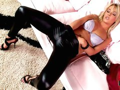 Sexy blonde in leather pants goes fingering