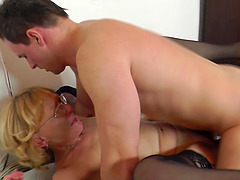 Experienced housewife with glasses impales herself on the cock
