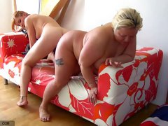 Mature blonde fattie and redhead teen share a dildo in lesbian scene