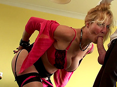 Mature granny enjoys the company of a cocky stud in a hotel room