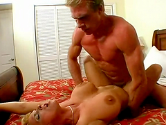 Horny fucker rides a big titty bitch