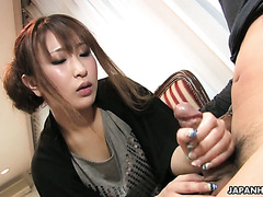 Yuki Maya is massaging her lover's hard cock with her silken fingers