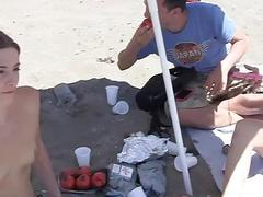 Wild college students fucking on a public beach