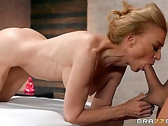 Masseur gets his cock sucked by a fit mature slut