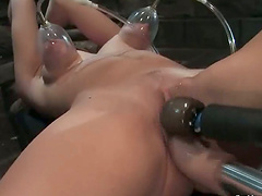 Harmony gets her holes drilled at the same time by a fucking machine