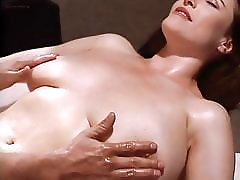 Mimi Rogers getting her giant breasts massaged.