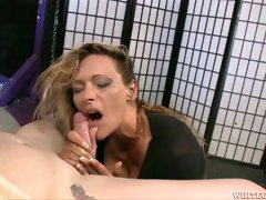 Cum starving auburn MILF in black stuff passionately blows strong dick