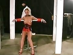 Slave bound by her neck is fucked by a vibrator
