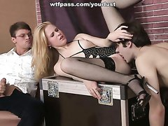 Salacious blonde in black stockings engages in MMF threesome