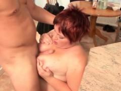 Big busty redhead gets her tits