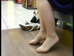 Shopping for high heels. Shapely legs in pantyhose.