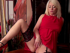 A blonde fucking slut gets naked for the camera and fingers herself