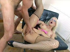 Tattooed blonde cougar love to suck on huge peckers