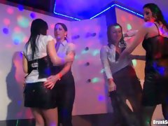 Kinky girls are dancing on a stage getting wet