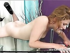 Butt plug babe pisses on a glass desk