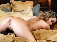 Sexy Asian Playboy model teases in bed