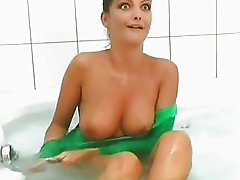 Erotic Chick In Green Nylon Suit Takes Shower