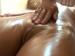 Pleasuring chick with oil massage